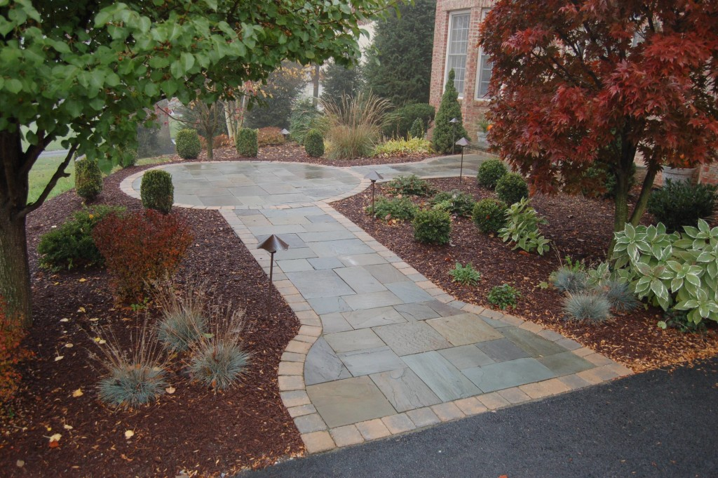 Flagstone walkway with paver soldier course
